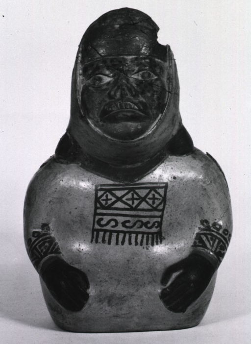<p>Sculpture:  Spouted urn of seated figure with facial spots and deformities.</p>