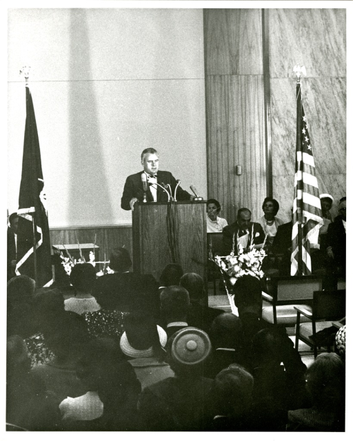 <p>Rhode Island Congressman, John Edward Fogarty, addresses the audience from the podium at the National Library of Medicine Dedication Ceremony.</p>