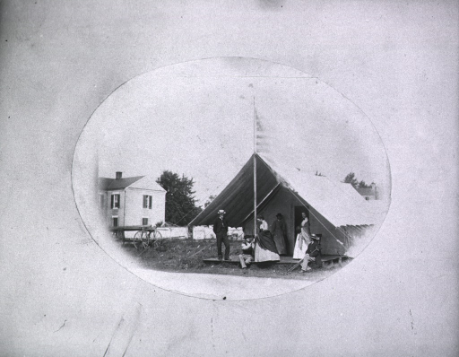 <p>Hospital tent, flag in front.</p>