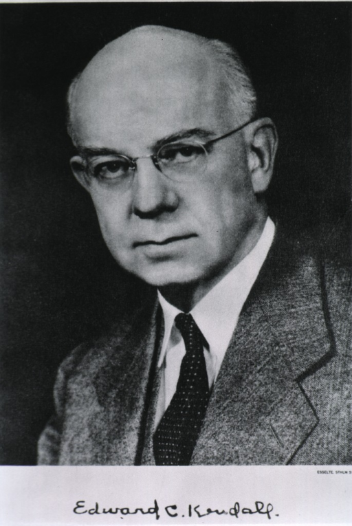 <p>Head and shoulders, half length, left pose, full face; wearing glasses.</p>