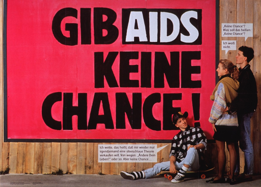 <p>Multicolor poster  with black and white lettering.  Title dominates poster.  Visual image is a color photo reproduction featuring three teens.  Two teens look at a fence or wall that bears the title text, asking what the saying means.  The other teen is seated with his back to the wall.  He appears to offer an explanation about someone wanting to sell him a theory about changing his life, to which he replies &quot;No chance.&quot;  Publisher information in lower left corner.</p>