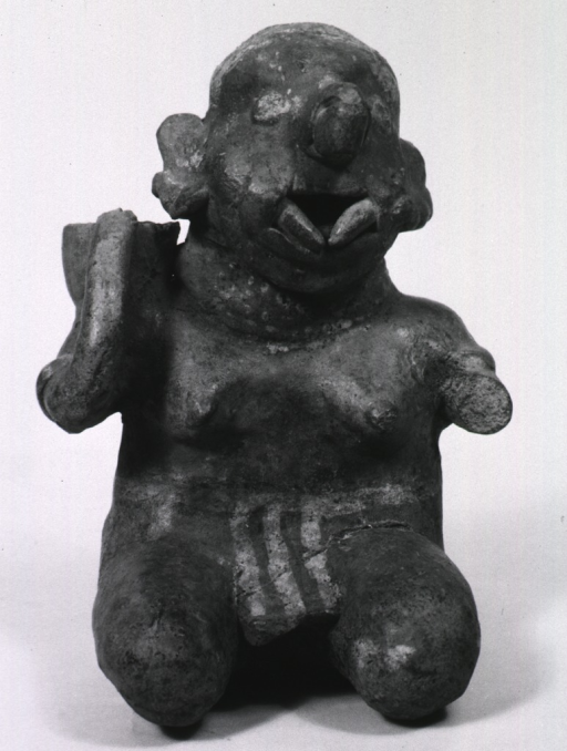 <p>Sculpture:  Kneeling female figure with jug over shoulder; face marked by the presence of two prosthetic devices in place in buccal cavity.</p>