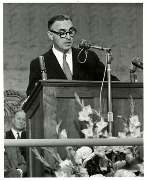 <p>Secretary of Health, Education and Welfare, Dr. Abraham Ribicoff, addresses the audience from the podium at NLM Dedication Ceremony, December, 1961.</p>