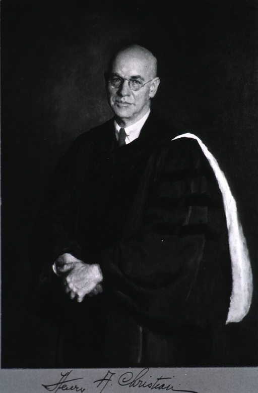 <p>Half-length, standing, full face, body to left, wearing academic robe.</p>