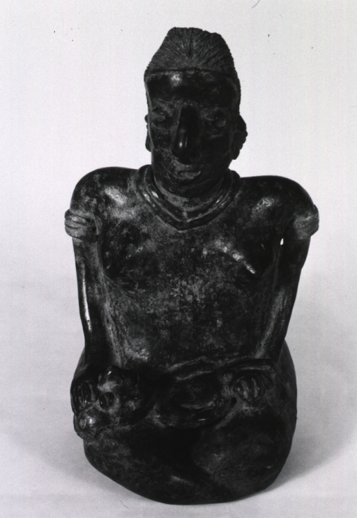 <p>Sculpture:  Seated female figure with child on her lap.</p>