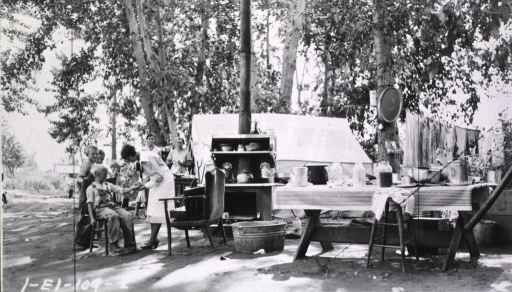 <p>Showing a nurse attending to children in a campground setting.</p>