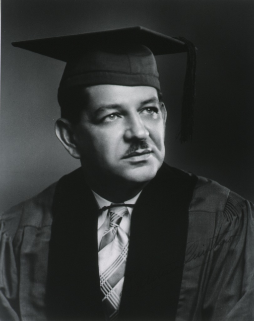 <p>Head and shoulders, right face, cap and gown.</p>