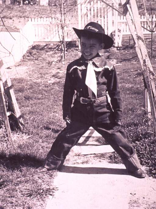 <p>A young boy dressed up as a cowboy.</p>