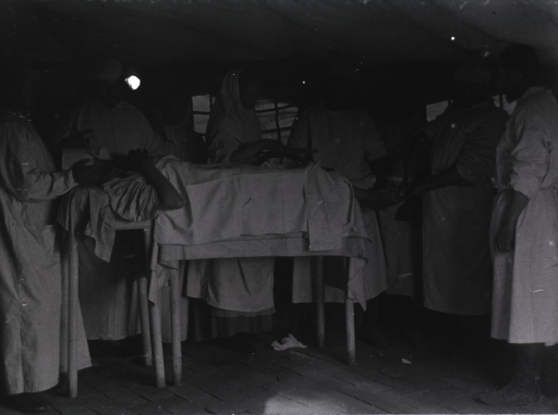 <p>Surgeons operating on a patient in the operating room at Mukden Field Hospital, 5th Division, Japanese Army(?).</p>