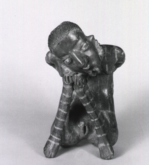 <p>Sculpture:  Seated, emaciated female with deformed mouth and limbs; head resting on knees.</p>