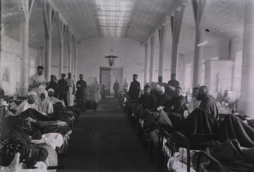 <p>A view of patients and Red Croos staff in a ward at Mukden Field Hospital, 5th Division, Japanese Army.</p>
