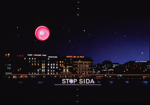 <p>Multicolor poster with white lettering.  Poster is predominantly a reproduction of a color photo of the Geneva skyline at night.  An illustration of a fresh, pink condom is superimposed on the photo as if to represent the moon.  Title and note superimposed on bottom of poster.  The &quot;o&quot; in stop is represented by a fresh condom.</p>