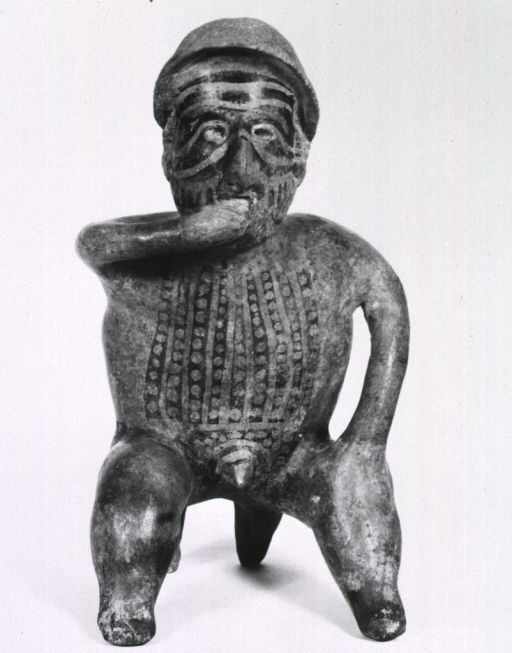 <p>Sculpture:  Seated male figure with right hand to mouth; extensive tatoo markings.</p>