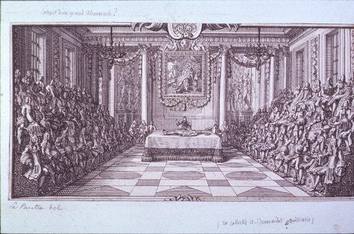 <p>Interior view of an anatomical theatre: a lecturer is standing behind a table with a cadaver on it; both sides of the room are lined with spectators.</p>