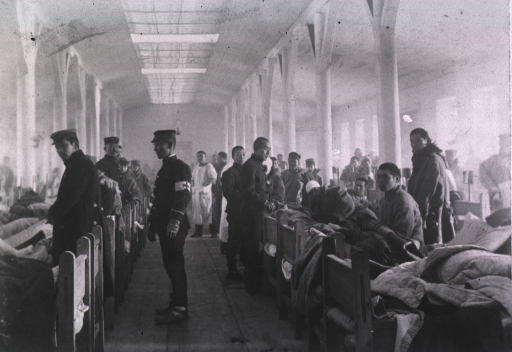 <p>View of patients and Red Cross personnel in Ward No. 2 at Mukden Field Hospital, 5th Division, Japanese Army.</p>
