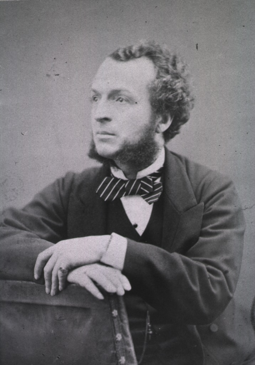 <p>Half-length, seated, left pose, hands together on back of chair.</p>