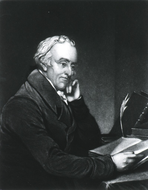 <p>Seated, hand to head; glasses on forehead; right pose; quill pen.</p>