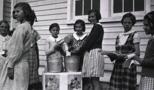<p>Showing a group of children from the Agricultural School, Atlantic Co. N.J., at a make-shift hand-washing assembly line.  Two buckets of water, a child holding a dipper, and another child handing out paper towels.</p>
