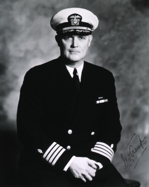 <p>Seated, wearing Naval uniform (Captain).</p>