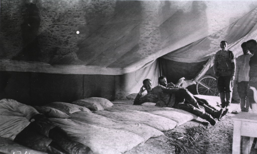 <p>Patients in a tent ward at Evacuation Commission Hospital.</p>