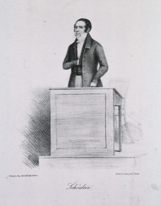 <p>Standing behind desk, one hand in vest, front pose.</p>