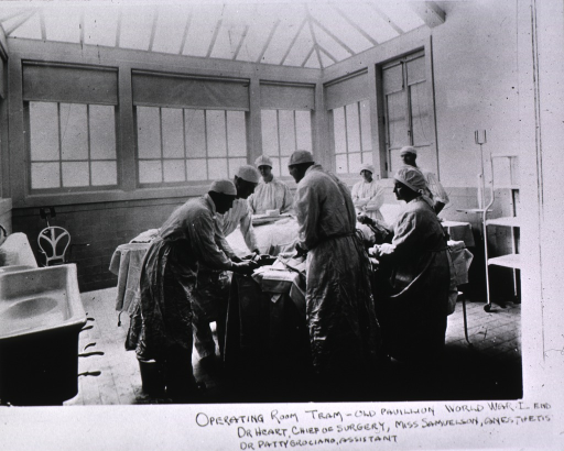 <p>Interior view of operating room with operation in progress.</p>