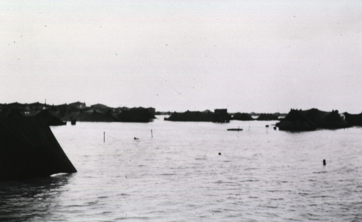 <p>Water inundates the field and partially submerges the tents of the 38th Evacuation Hospital.</p>