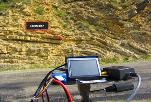 Positioning of the multispectral camera with respect to a rock formation including the Spectralon placed on the wall of the rock.