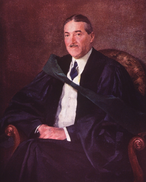 <p>Three quarter length, full face, body to left, wearing academic robe, seated in arm chair, hands clasped in lap.</p>