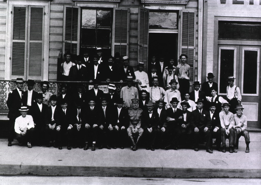<p>Group portrait of U.S. Public Health Service workers in front of the sanitary district no. 2 headquarters during the New Orleans plague campaign.</p>
