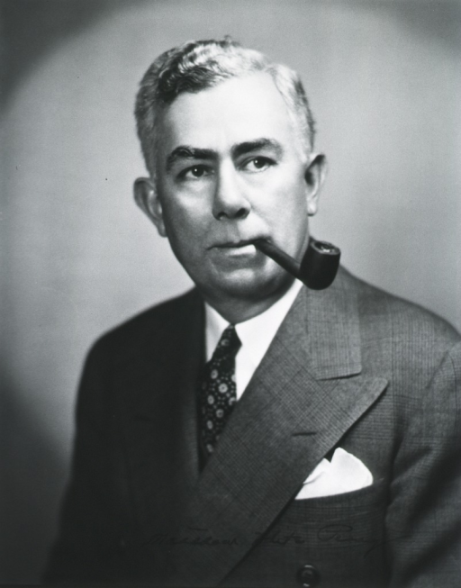 <p>Head and shoulders, full face, pipe in mouth.</p>