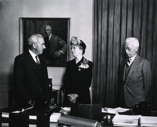 <p>Standing behind desk with Dr. Thomas Parran and Dr. Rolla Dyer, on the occasion of the award of the Typhus Commission Medal, Nov. 3, 1947.  Portrait of Dr. Cummings in background.</p>