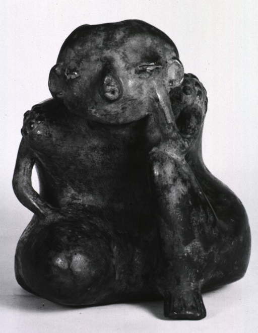 <p>Sculpture:  Seated male figure with thin arms and leg (right leg apparently removed); shoulder markings.</p>