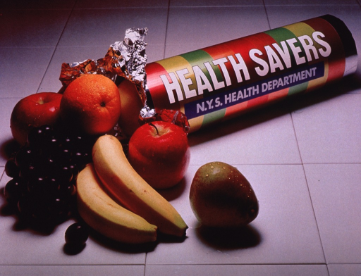 <p>Multicolor poster with white lettering.  Visual image is a color photo reproduction featuring several types of fruit emerging from a brightly striped tube; the tube is suggestive of a roll of Life Savers candy.  Title text and publisher information on tube.</p>