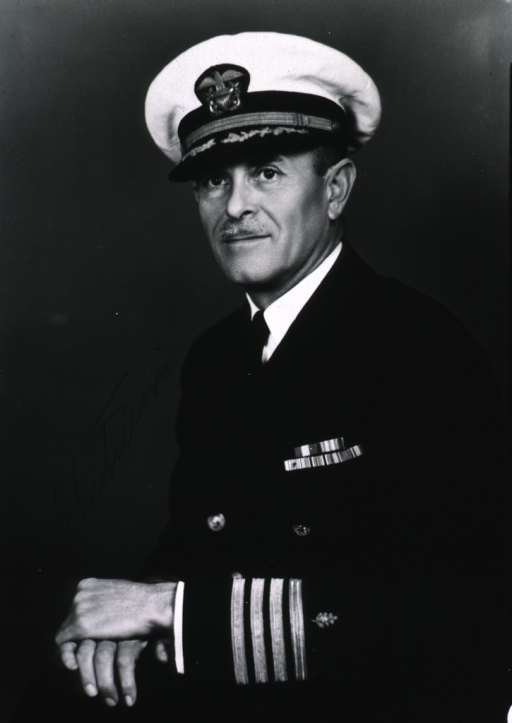 <p>Three-quarter length, seated, left pose, hand folded on knee, wearing uniform and cap (Captain, U.S. Navy).</p>