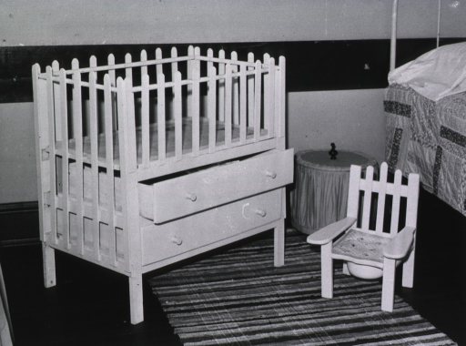 <p>Showing a homemade combination crib/dresser, and a matching poddy-seat.</p>