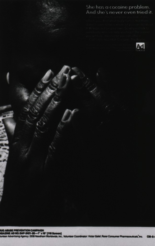 <p>Close-up of a black woman with her hands over her face.</p>