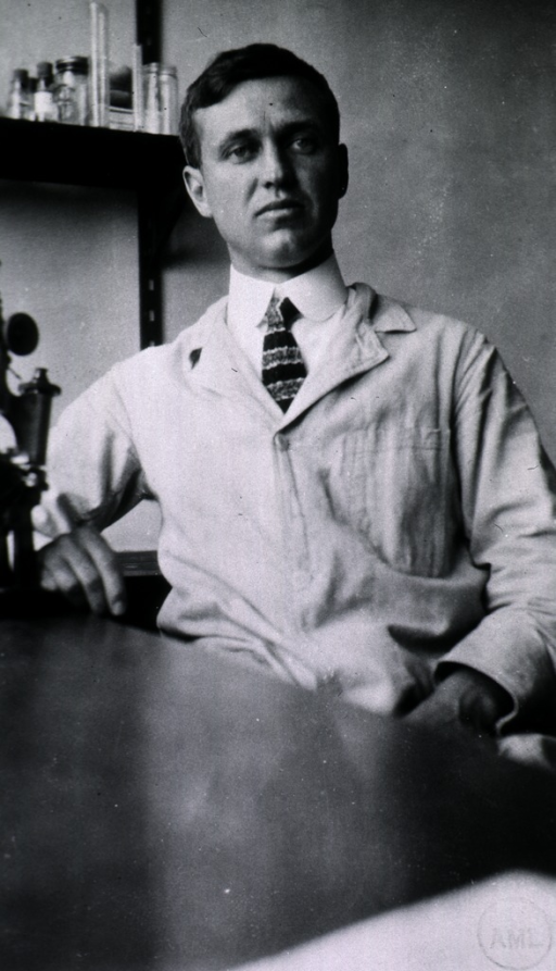 <p>Seated at table in laboratory.</p>