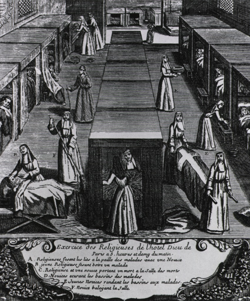 <p>Nuns at work on a ward at the Hotel-Dieu, Paris, in the early morning.</p>