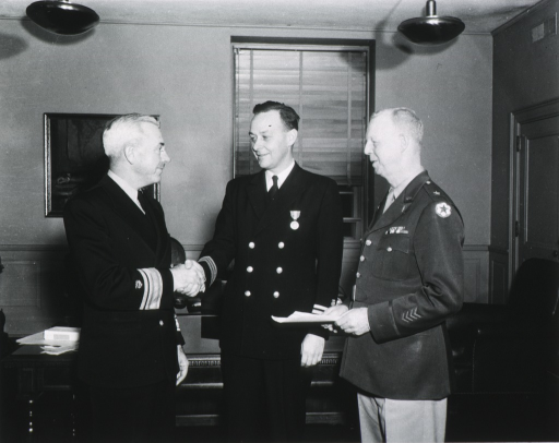 <p>Three quarter length, standing with Dr. Parran on left and Dr. Bayne-Jones on right.</p>