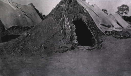 <p>Shelter tents made from mud and twigs in Gungalin.</p>