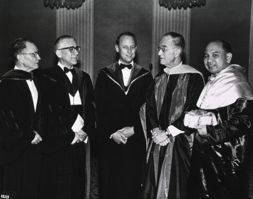 <p>Group picture including Irvine H. Page, M.D. and Donald S. Fredrickson at the American College of Cardiology, ca. 1964.  There are five men altogether in the picture, all wearing academic robes of different styles and with different hoods.</p>