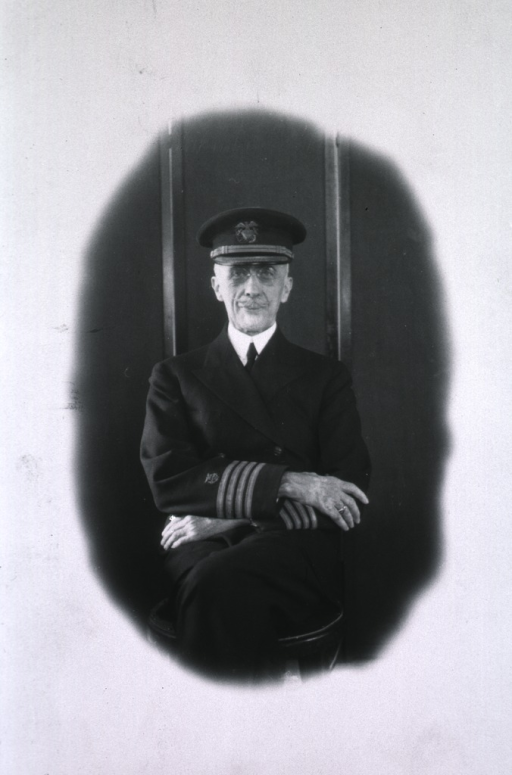 <p>Three-quarter length, seated, full face, wearing USPHS uniform and cap.</p>