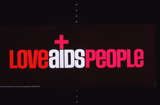 <p>Brown poster with multicolor lettering.  Title dominates center of poster.  A small cross or plus sign sits atop the &quot;i&quot; in AIDS.  Publisher information in lower left corner.  No other images or text on poster.</p>