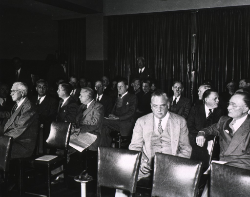 <p>Interior view:  Attendees seated at the fifth annual meeting (1948) of the Association of the Honorary Consultants to the Army Medical Library.  Col. Jones is at extreme left, front row.  Dr. Leake standing at back of room.</p>