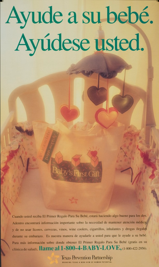 <p>Inside a crib with a mobile is a Baby's First Gift canvas bag.</p>