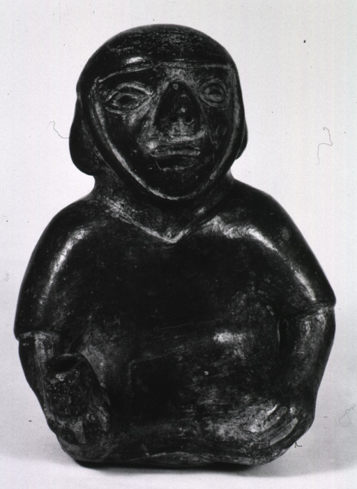 <p>Sculpture:  Spout-type of vessel of a seated figure with nasal deformity.</p>