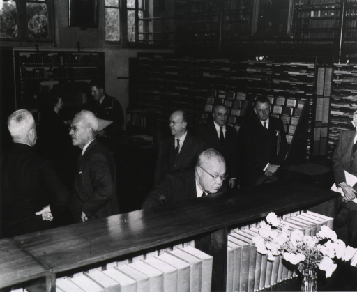 <p>Interior view:  People are gathered in the reading room.</p>