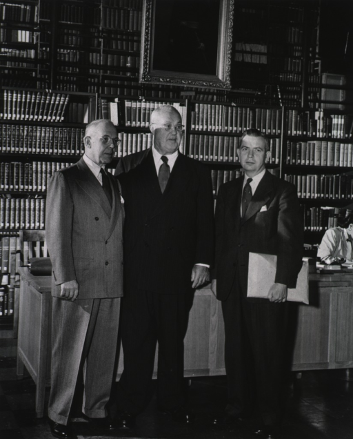 <p>Interior view:  Eighth annual meeting of the Association of the Honorary Consultants to the Army Medical Library.  Standing in the Library Hall reading room are Henry Viets, Wilburt Davison and Thomas Keys.</p>
