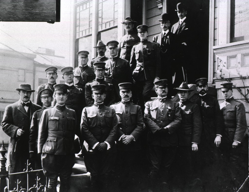 <p>Group portrait of P.A. Surgeon Rupert Blue (first row, fourth from right), members of his staff, and three men in civilian clothes, standing in front of the San Francisco Plague Suppressive Headquarters at Filmore &amp; Page Sts., San Francisco, Calif. during the San Francisco plague campaign.</p>